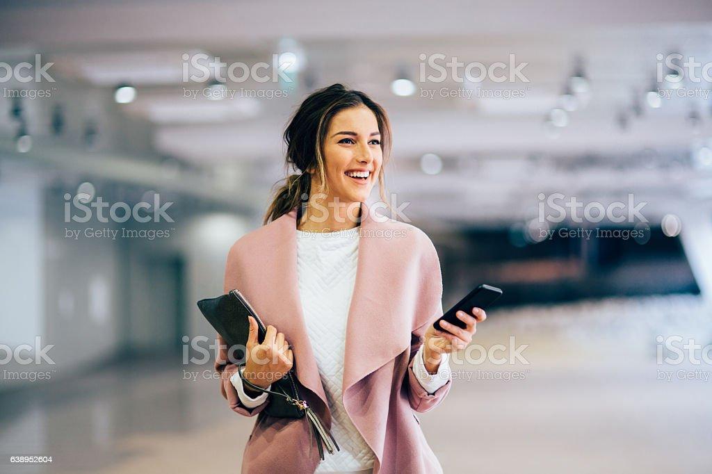 Happy beautiful woman texting stock photo