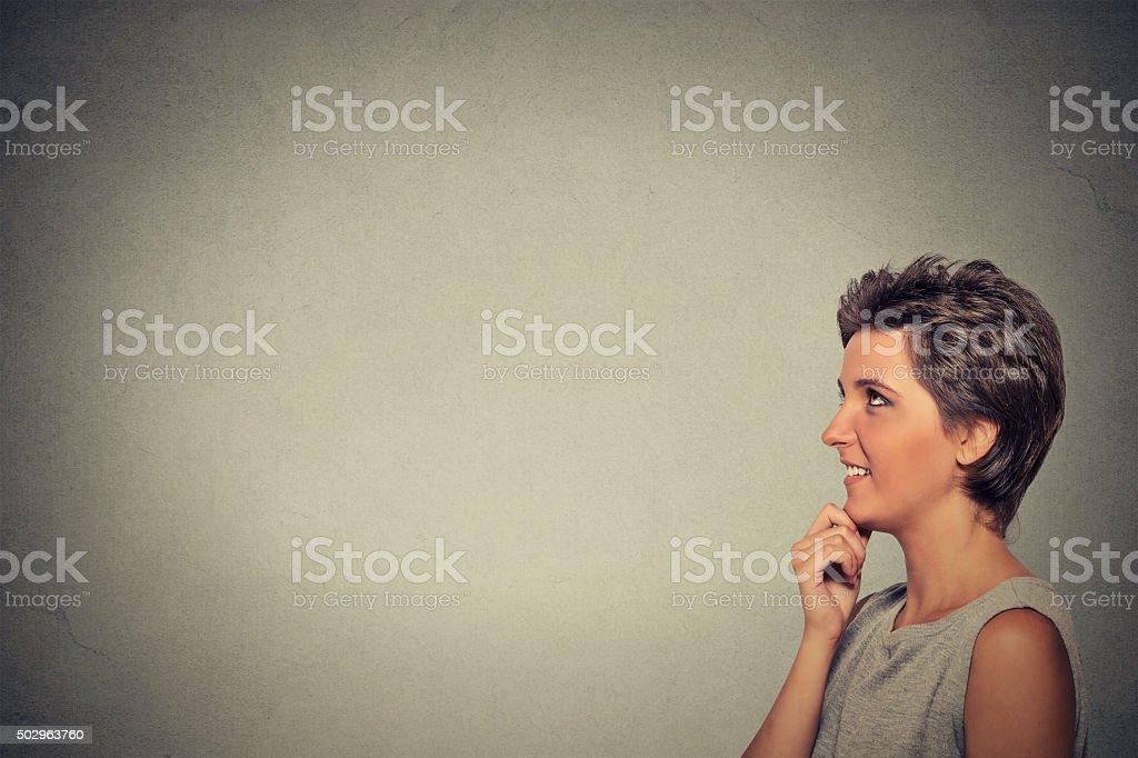 happy beautiful woman thinking looking up stock photo