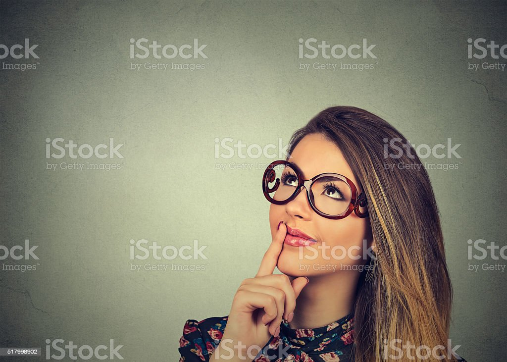 happy beautiful woman thinking looking up stock photo