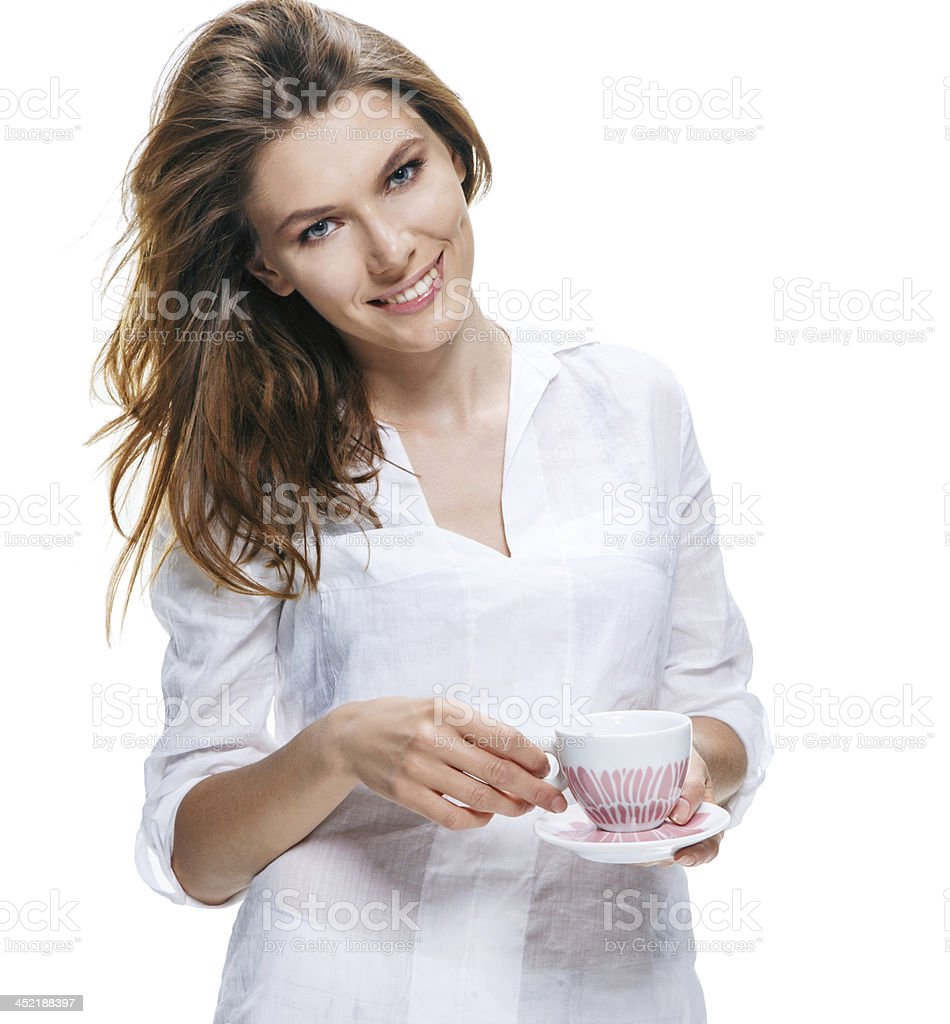 Happy beautiful woman with coffee cup in hands isolated royalty-free stock photo