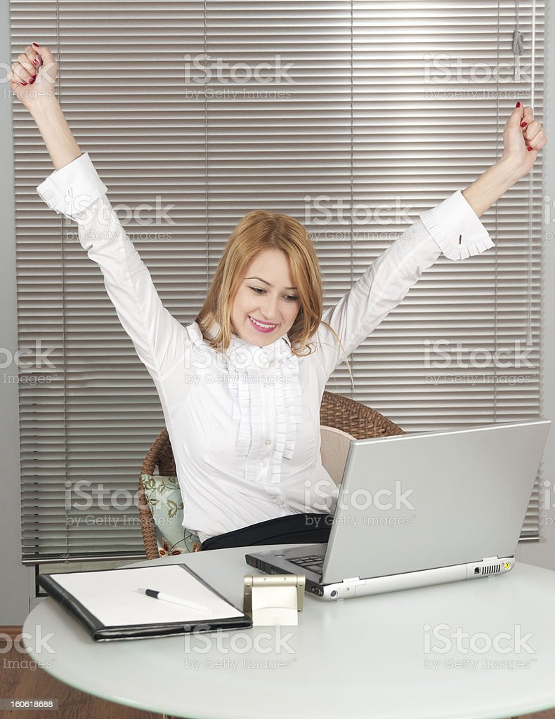 Happy beautiful young lady using laptop royalty-free stock photo