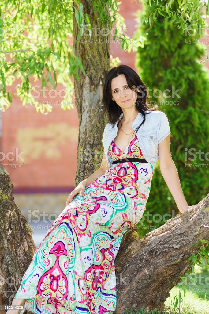 Happy beautiful young woman in the Park stock photo