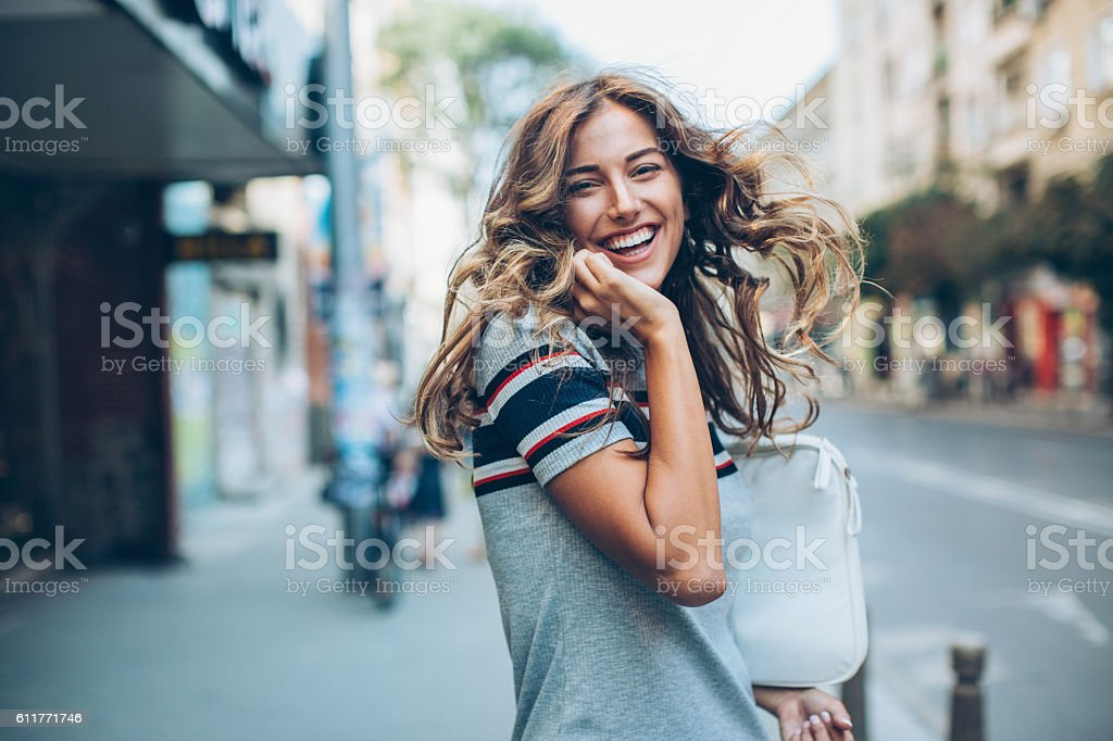 Happy beautiful young woman stock photo