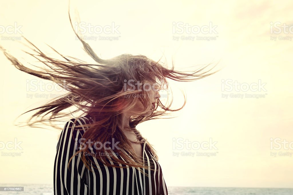 happy beautiful young woman shaking hair stock photo