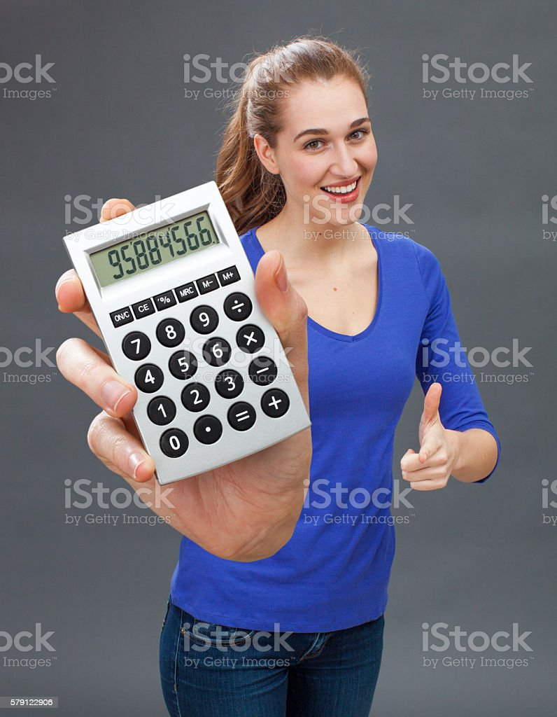 happy beautiful young woman with dynamic financial success and satisfaction stock photo