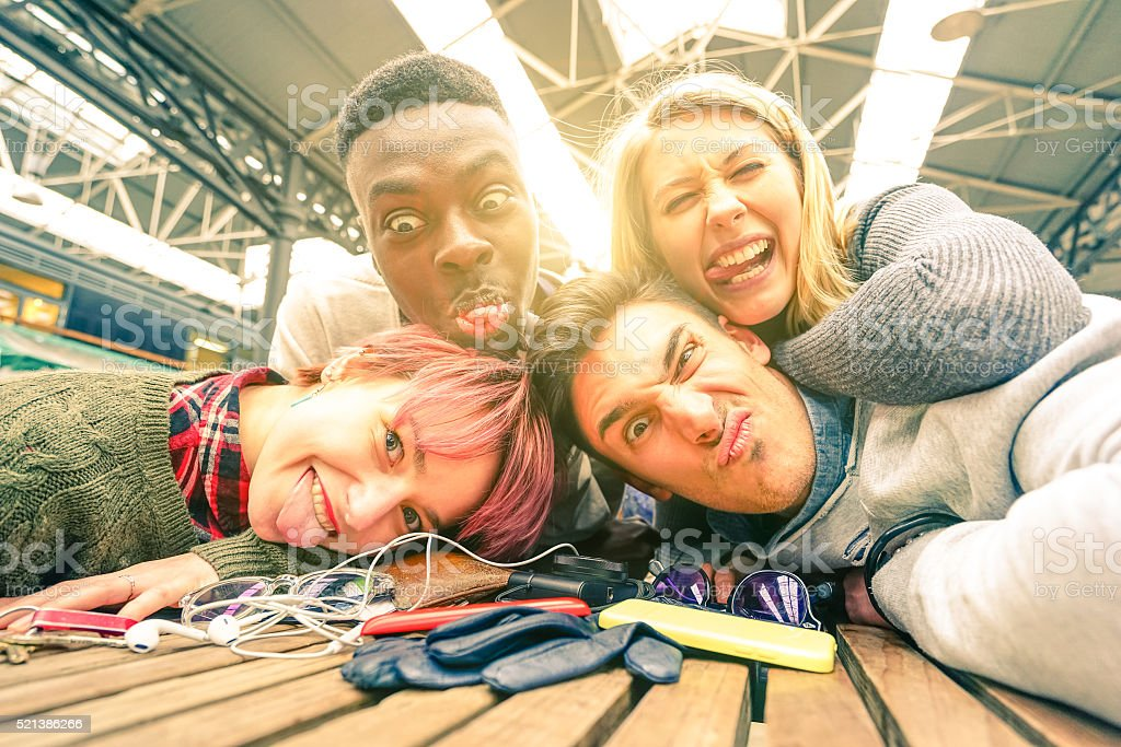 Happy best friends taking selfie and having fun together stock photo