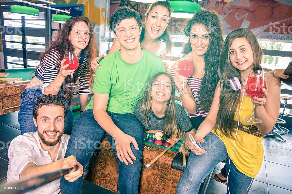 Happy best friends taking selfie at billiard pool table stock photo