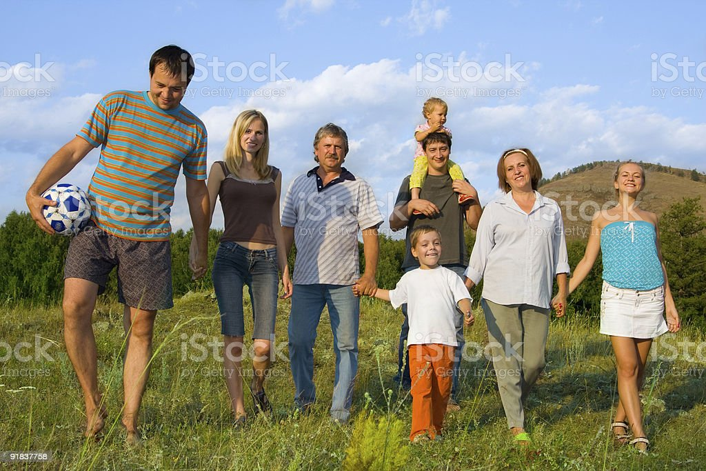 Happy big family on the nature stock photo