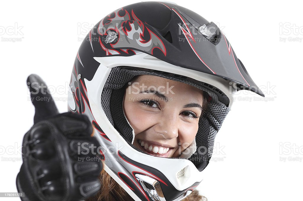 Happy biker woman with a motocross helmet and thumb up stock photo