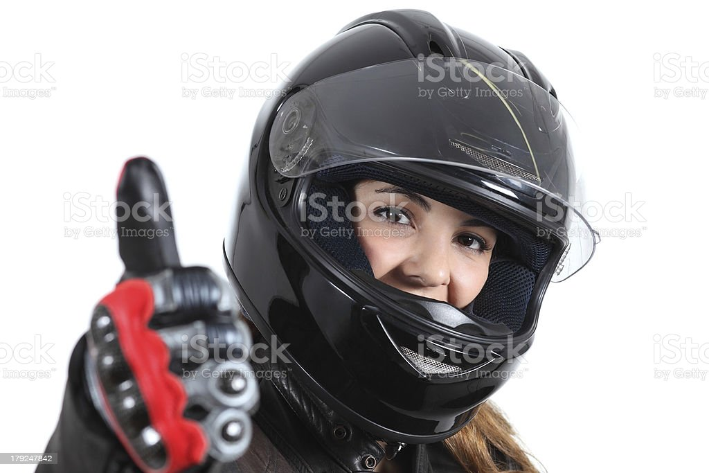 Happy biker woman with a road helmet and thumb up stock photo