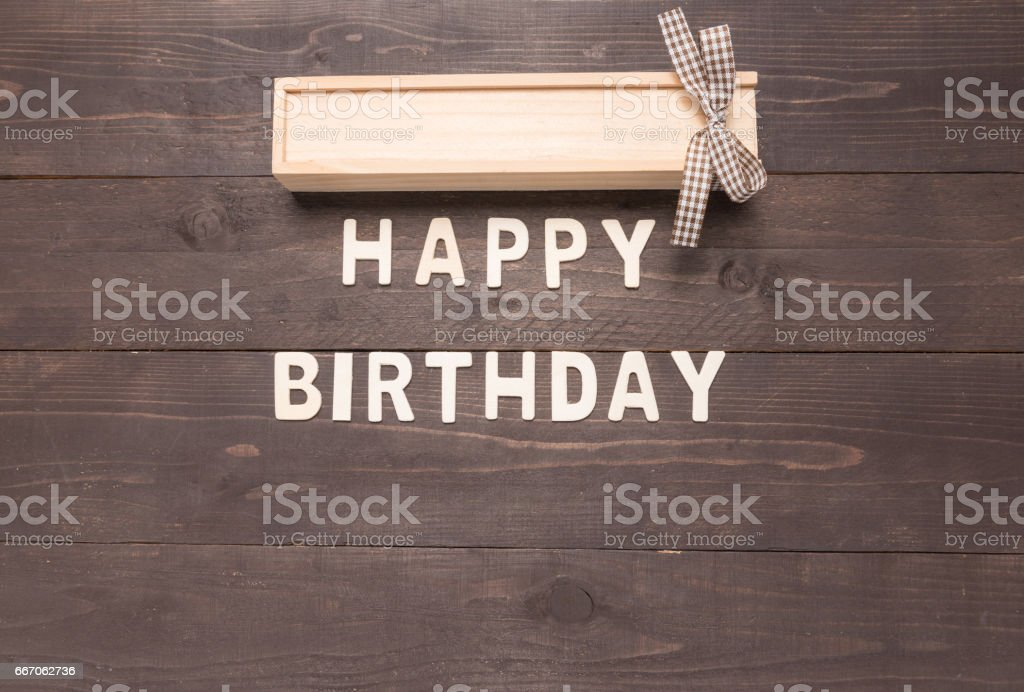 Happy Birthday and gift box on wooden background with copy space stock photo