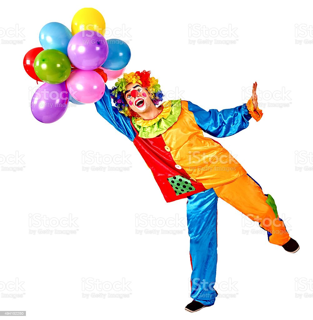 Happy birthday clown holding a bunch of balloons stock photo