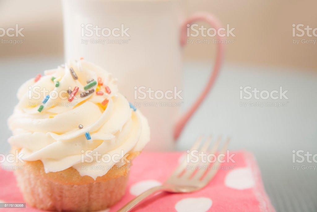 Happy Birthday cupcake.  Coffee, fork, pink napkin. stock photo
