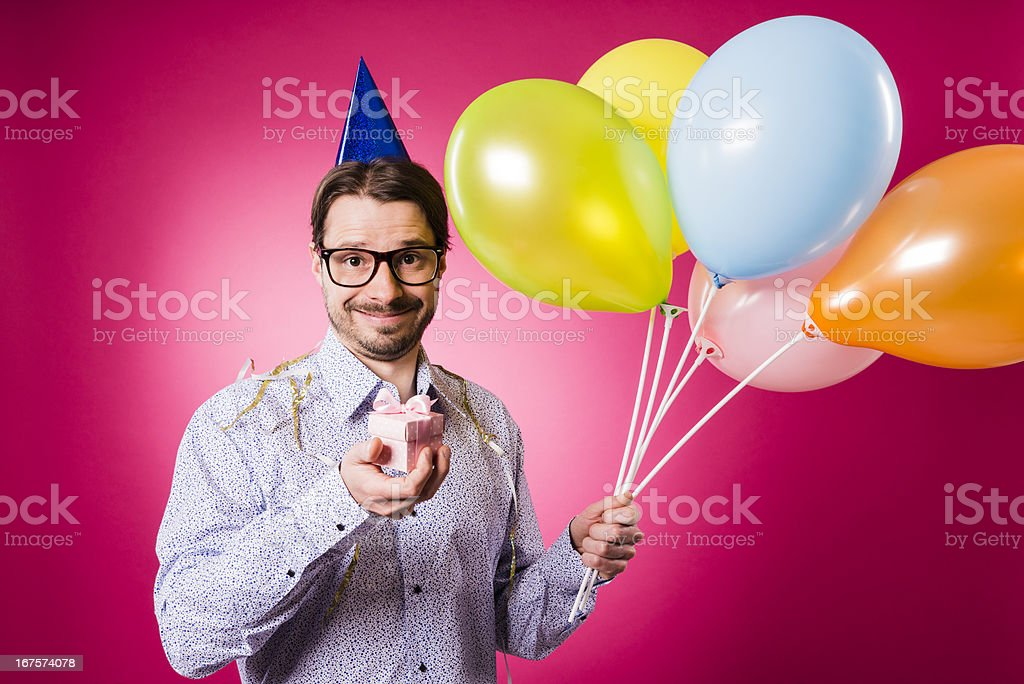 Happy birthday Geek man with pink gift and multicolored balloons royalty-free stock photo