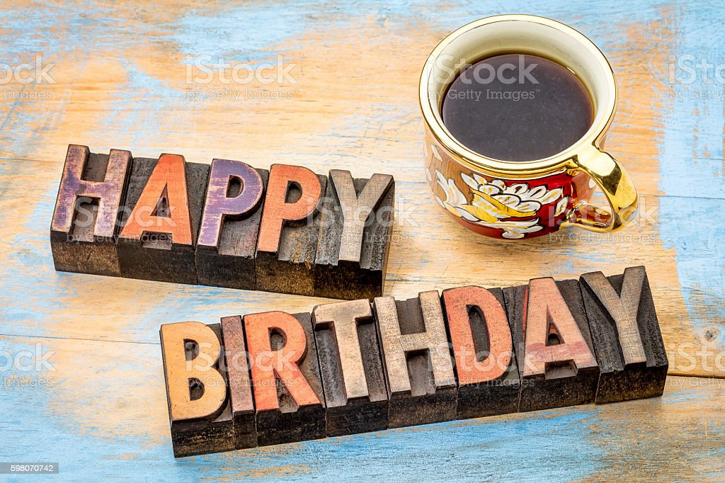 Happy Birthday in wood type with coffee stock photo