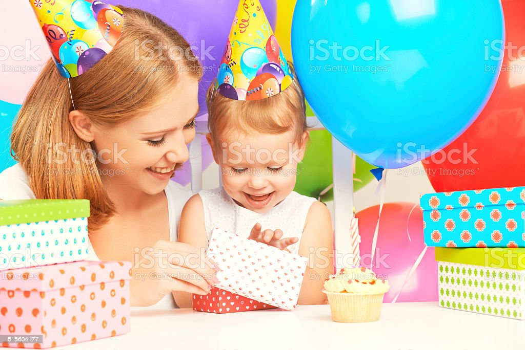 happy birthday. mother giving  gift to his little daughter stock photo