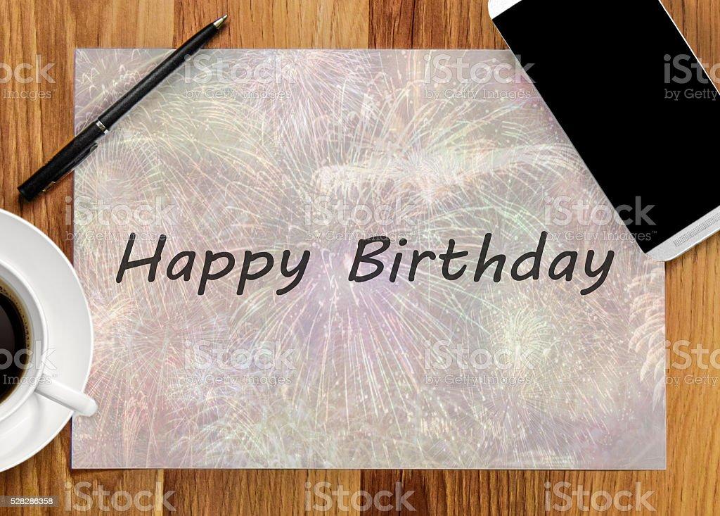 Happy Birthday on mix desktop office stock photo