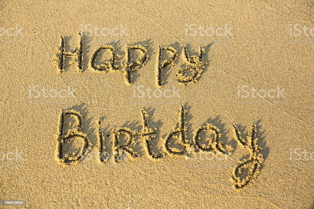 Happy Birthday -  the inscription, texture of sand. stock photo