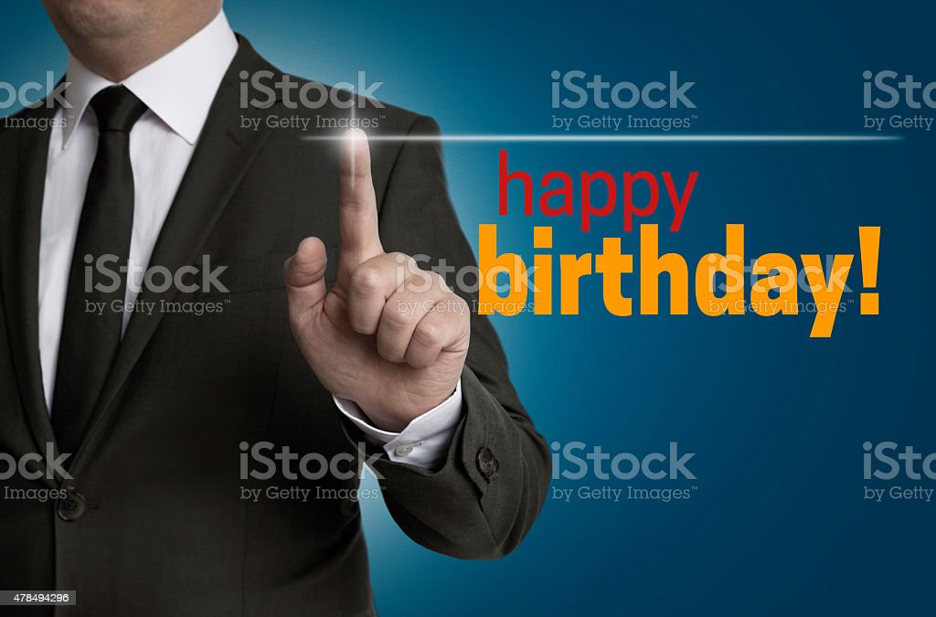 Happy Birthday touchscreen is operated by businessman stock photo