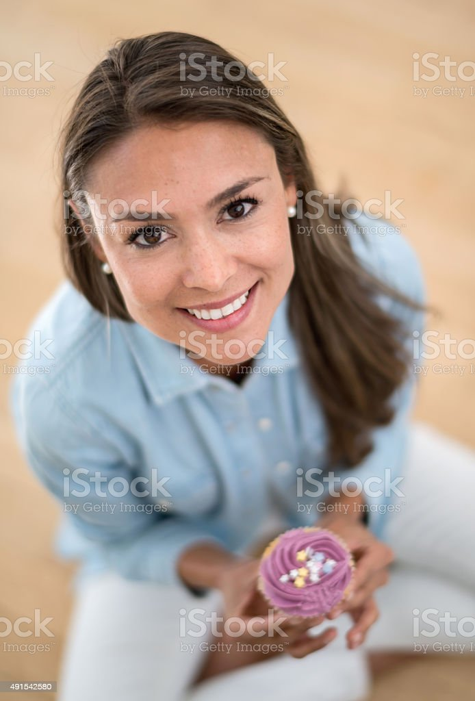 Happy birthday woman holding a cupcake stock photo