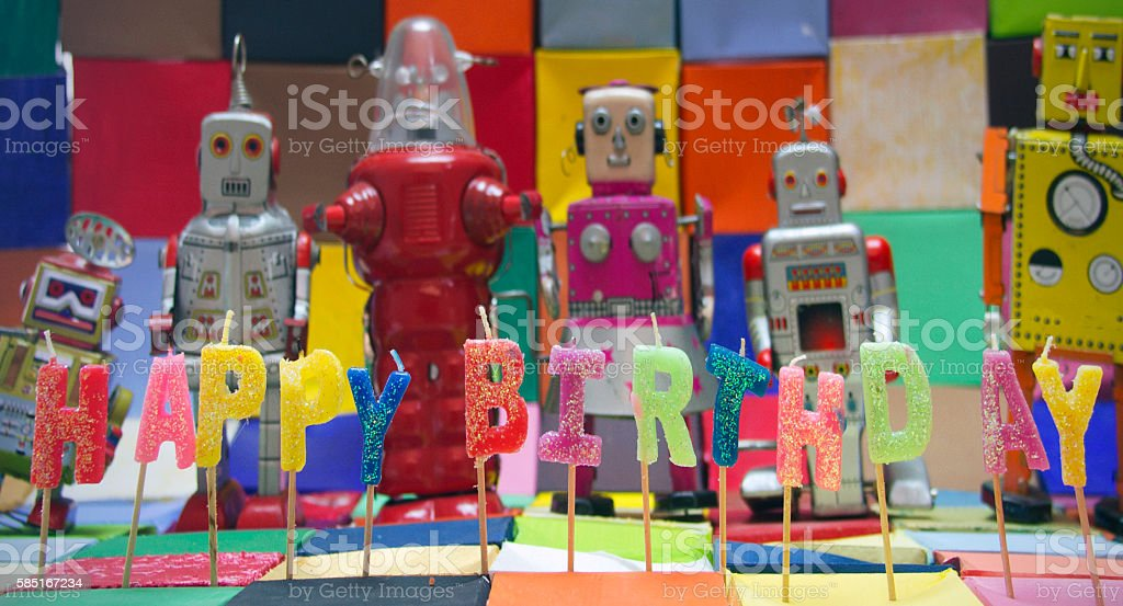 Happy Bithday candels and vintage robot toys stock photo