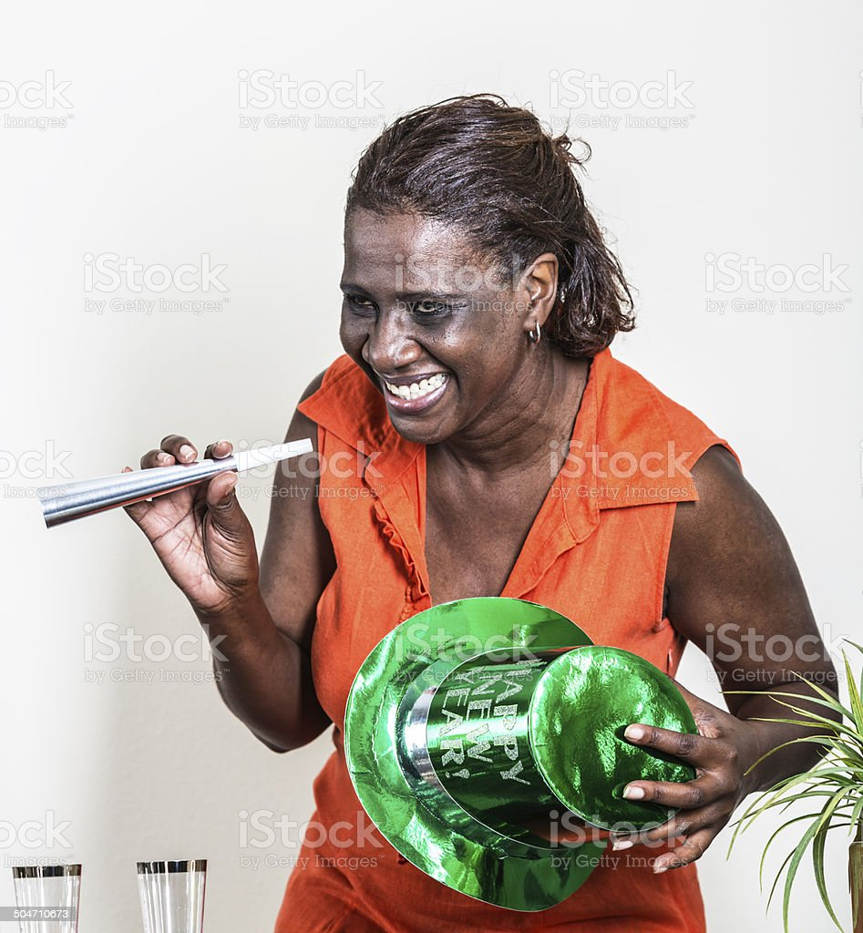 Happy Black Woman At New Year's Party stock photo