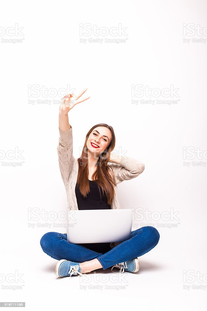 Happy black woman with arms raised and computer stock photo