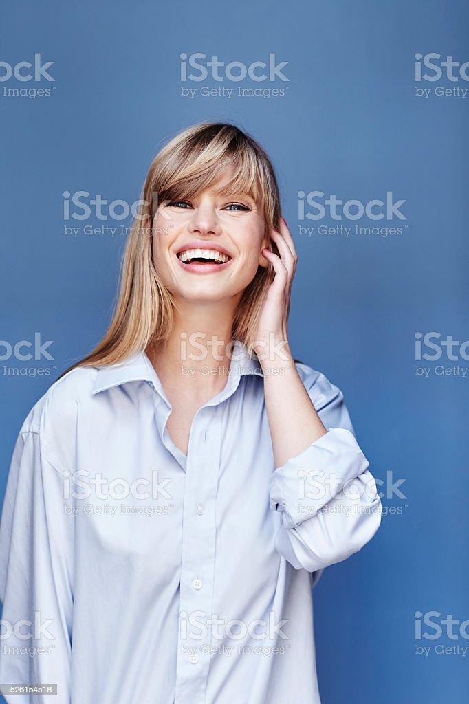 Happy blond beauty in blue shirt, portrait stock photo