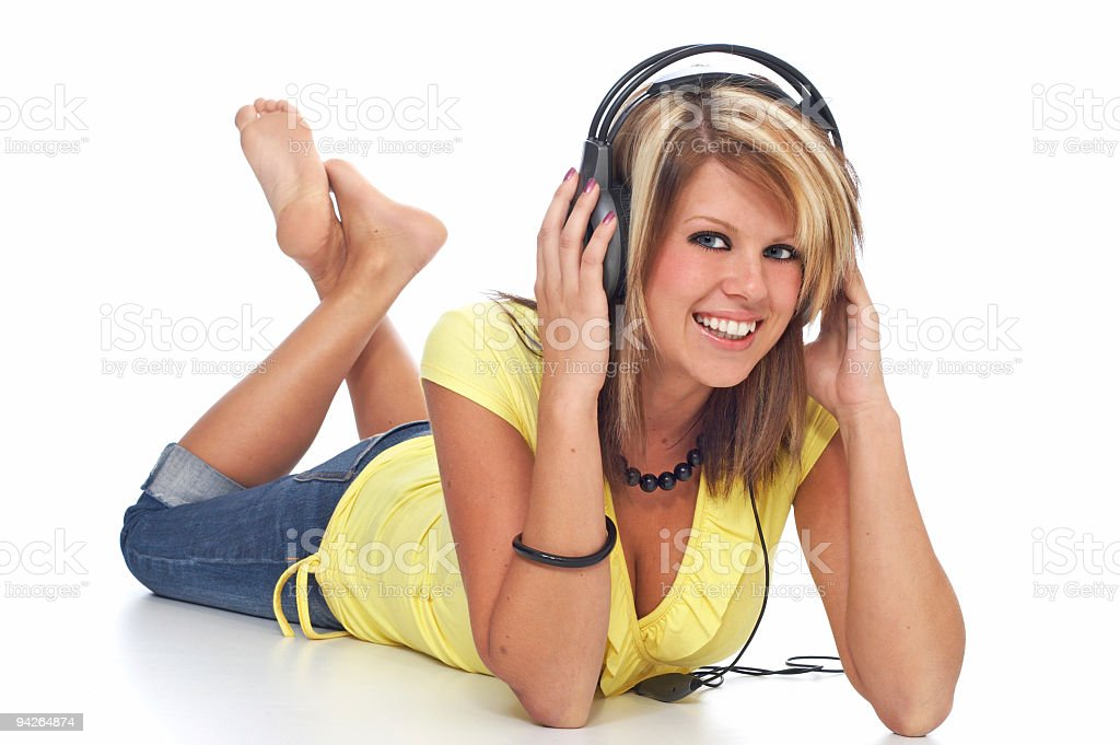 Happy blond girl with headphones royalty-free stock photo