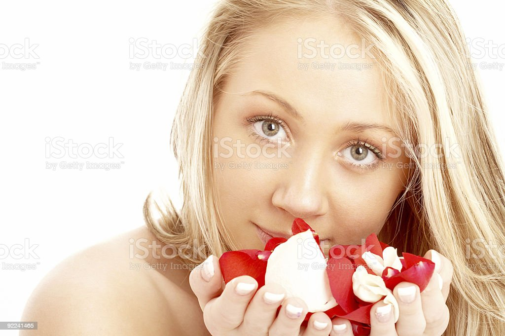 happy blond in spa with red and white petals royalty-free stock photo