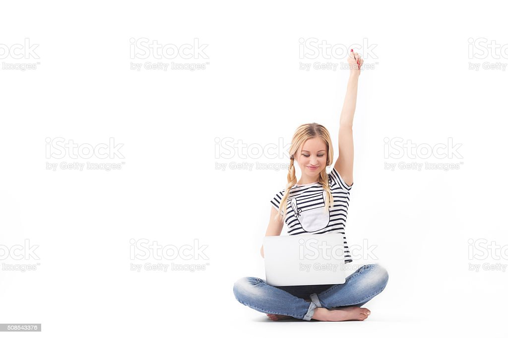 Happy blond woman on laptop stock photo