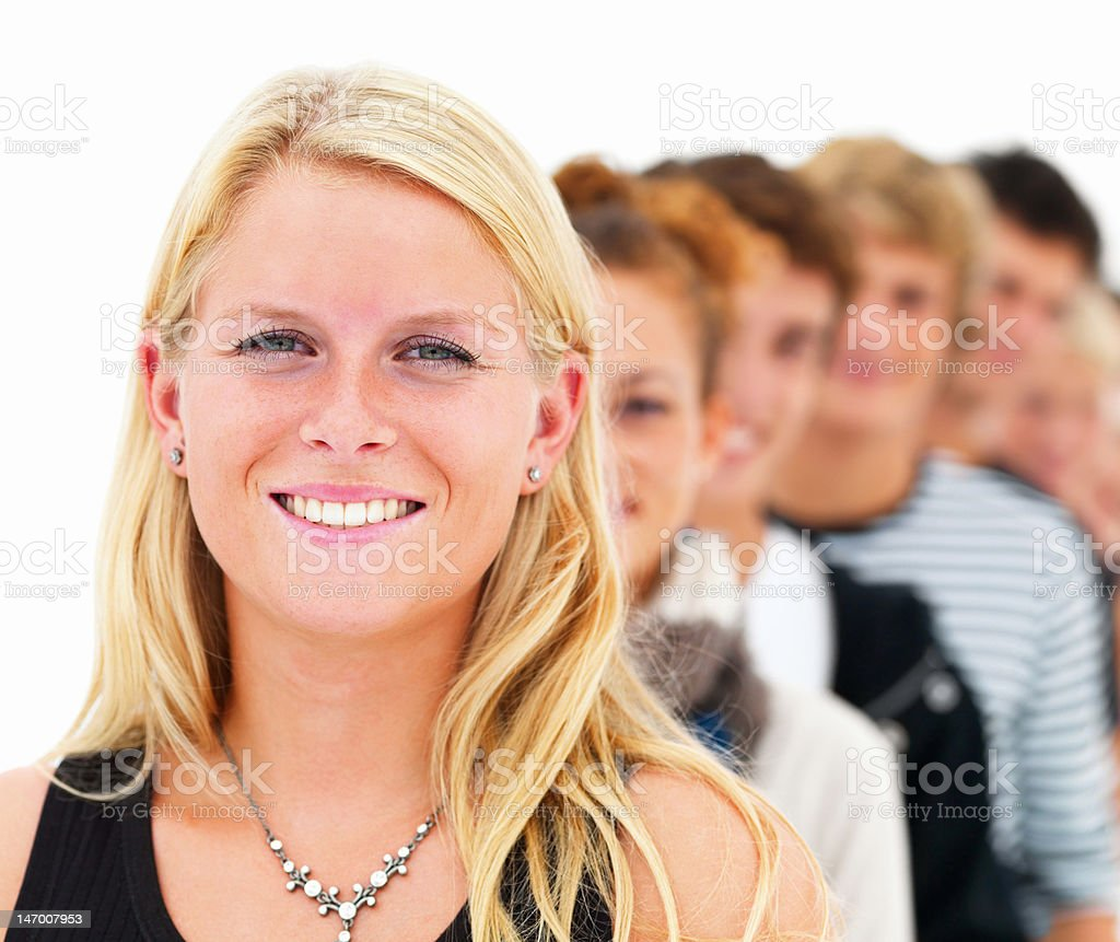 Happy blond young woman with friends in the background royalty-free stock photo