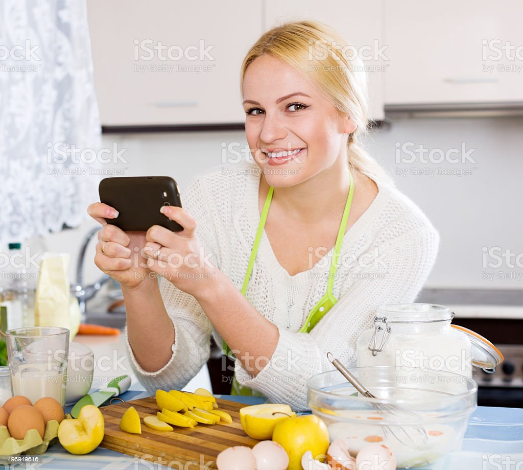 Happy blonde taking photoes stock photo
