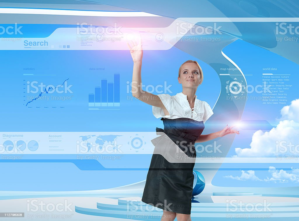 Happy blonde using technologies of the future royalty-free stock photo