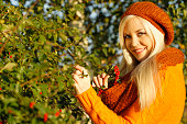 Happy blonde woman in autumn with scarf and pullover