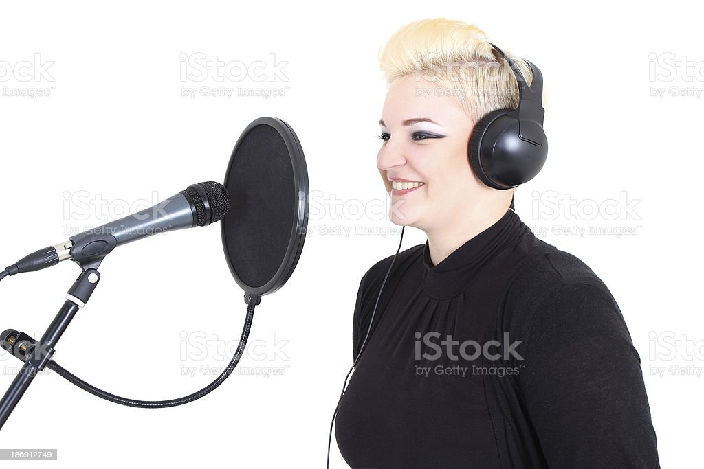 Happy blonde woman with microphone royalty-free stock photo