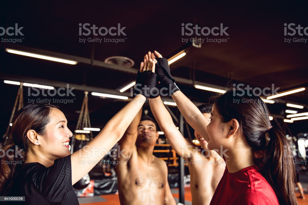 Happy boxing team celebrate together after workout stock photo