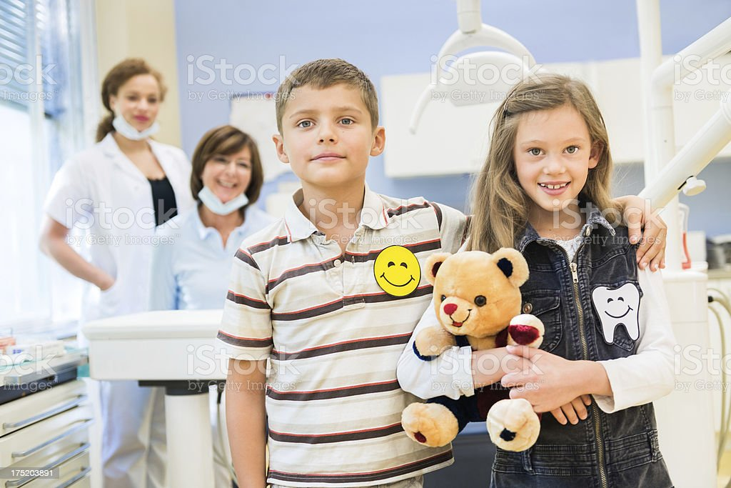 Happy Boy and Girl at the Dentist stock photo