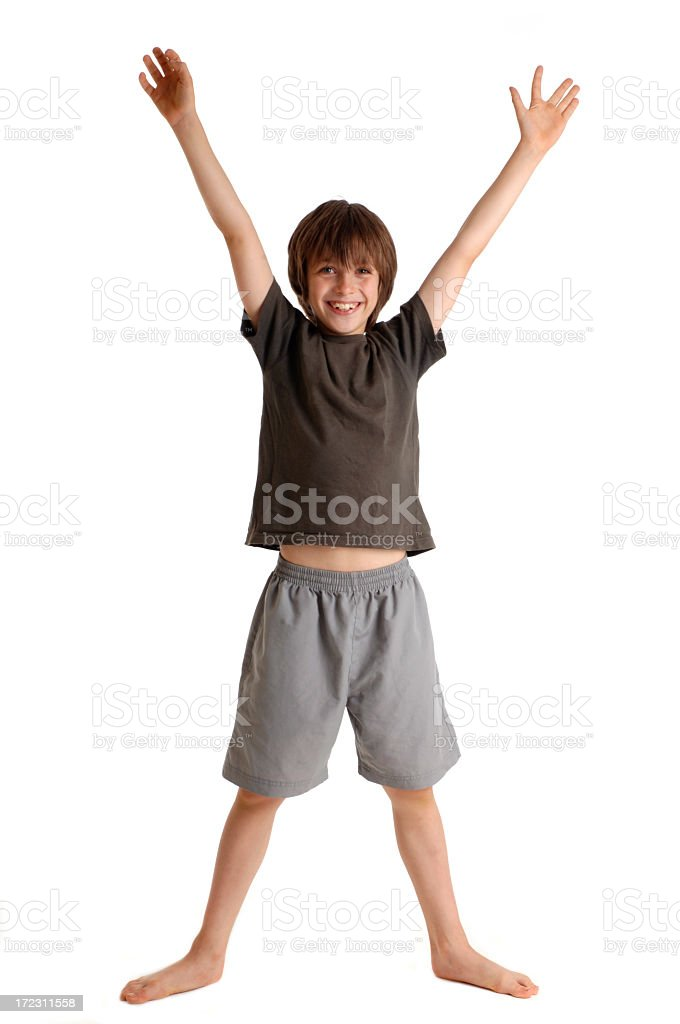 Happy boy arms and legs spread as an X stock photo