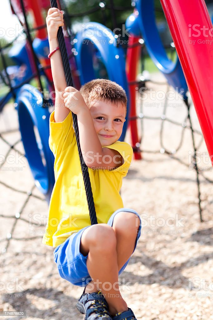 Happy boy at a playground royalty-free stock photo