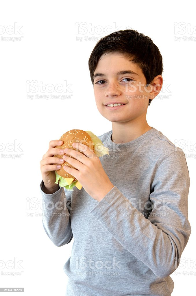 Happy Boy eating a burger and smiling. royalty-free stock photo