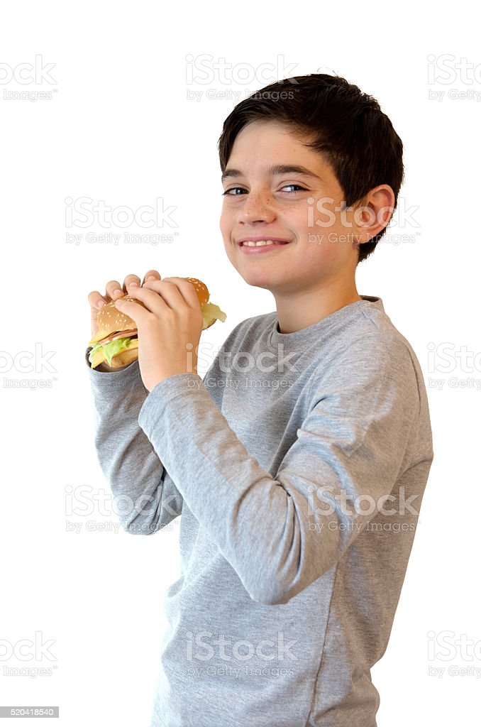 Happy Boy eating a burger and smiling royalty-free stock photo