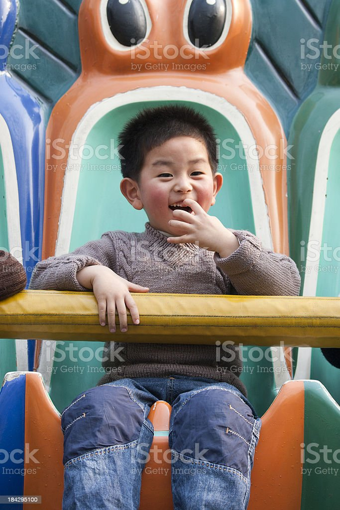 happy boy having fun at a carnival stock photo