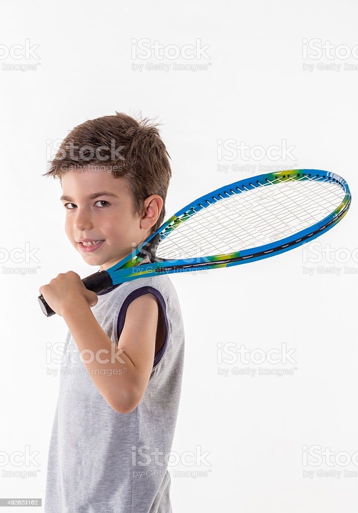 happy boy holding racket stock photo