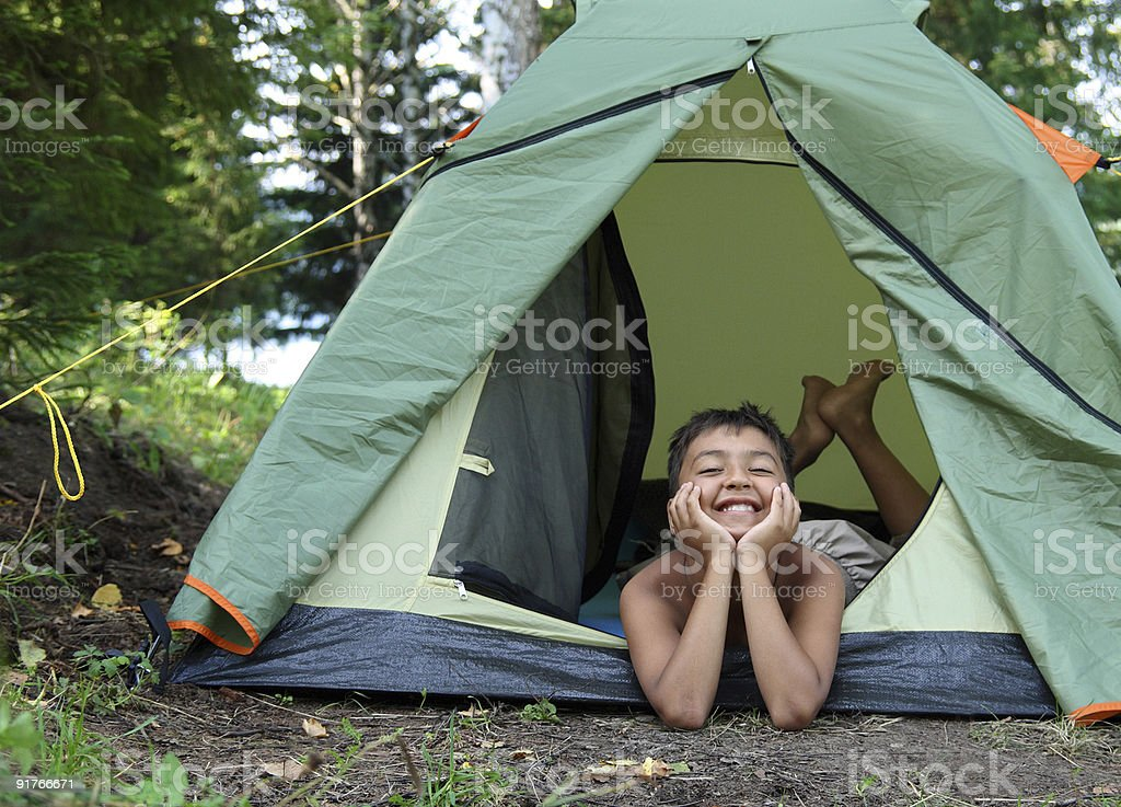 happy boy in camping tent royalty-free stock photo