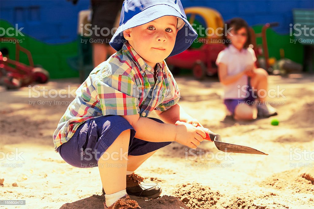Happy Boy in the Sandbox stock photo