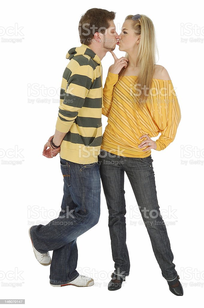happy boy kissing a nice girl stock photo