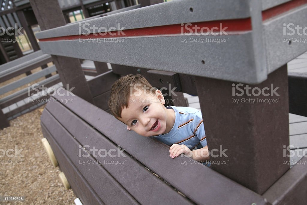 Happy Boy Looking Through at Playground royalty-free stock photo