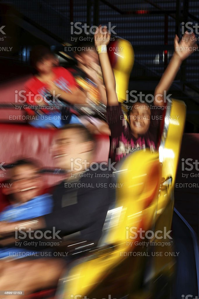 Happy boy on a funfair ride stock photo