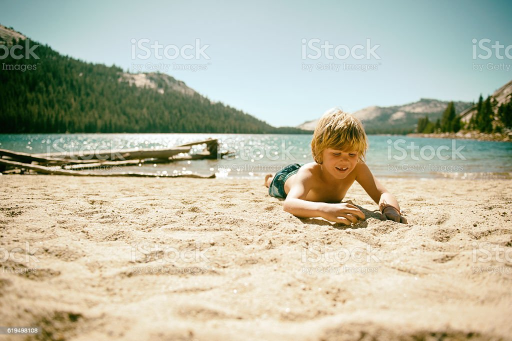 Happy boy on beach in Yosemite Ca stock photo
